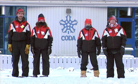 Snowshoers standing in front of Canada Olympic Development Association building