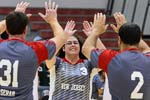 a coach giving her athletes a high 5