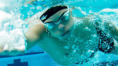 Underwater photo of a swimmer passing by
