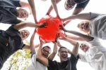 a group of people holding a Special Olympics Ball
