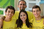four people with yellow t shirts posing