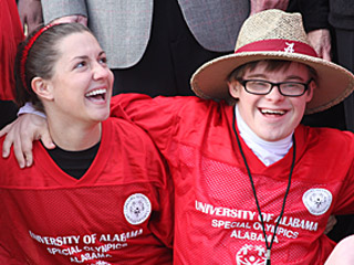 A college unified sports pair laughing and enjoying the moment.