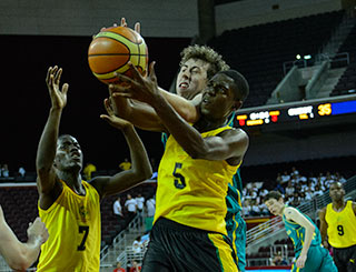 A basketball action shot: two players grab for the ball