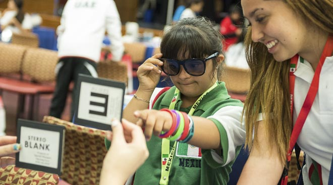 Special Olympics Mexico swimmer Michelle Falcon has her vision tested.