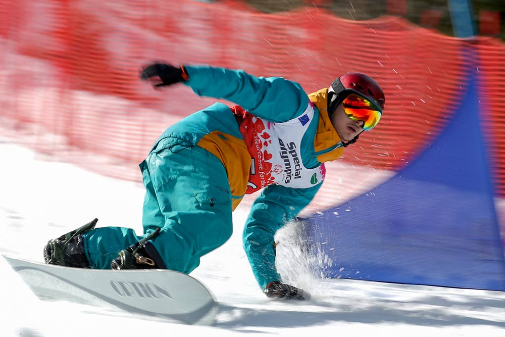 Snowboarder zooms downhill